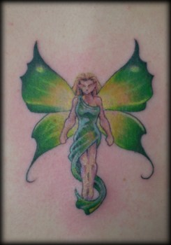 Tiny fairy tattoo