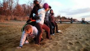 Standard version of the fitness game Caterpillar Crawl done on the beach