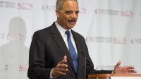 Holder, 'still attorney general,' pushes voting rights