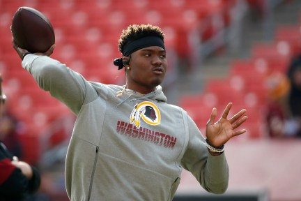 In this Dec. 22, 2019, file photo, Washington Redskins quarterback Dwayne Haskins works out prior to an NFL football game against the New York Giants, in Landover, Md.