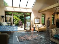 GAP Interiors - Modern living room with grey tiled floor ...