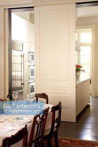 GAP Interiors - Sliding door between kitchen and dining ...