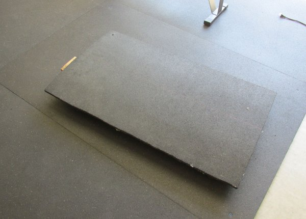 Working with securing stall mats in a garage gym