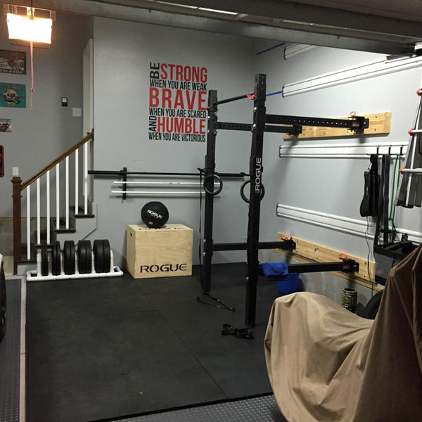 Fully equipped garage gym with space for the car gyms