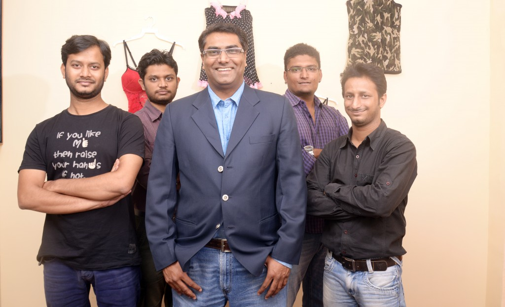Samir Saraiya, CEO of That's Personal (center) with the team