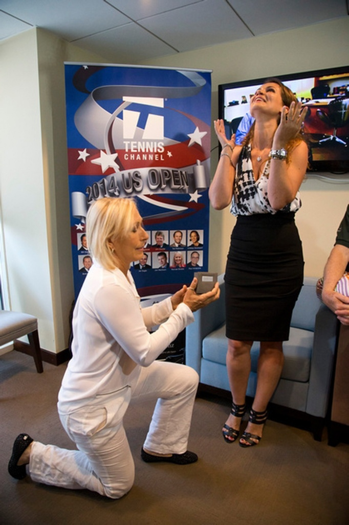 Martina Navratilova, left, proposes to Julia Lemigova at Arthur Ashe Stadium in New York. (AP Photo/cameraworkusa, Fred and Susan Mullane)