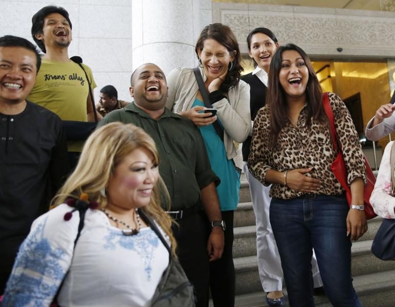 Transgender rights activists celebrate the ruling outside the court in Putrajaya. Picture: Reuters