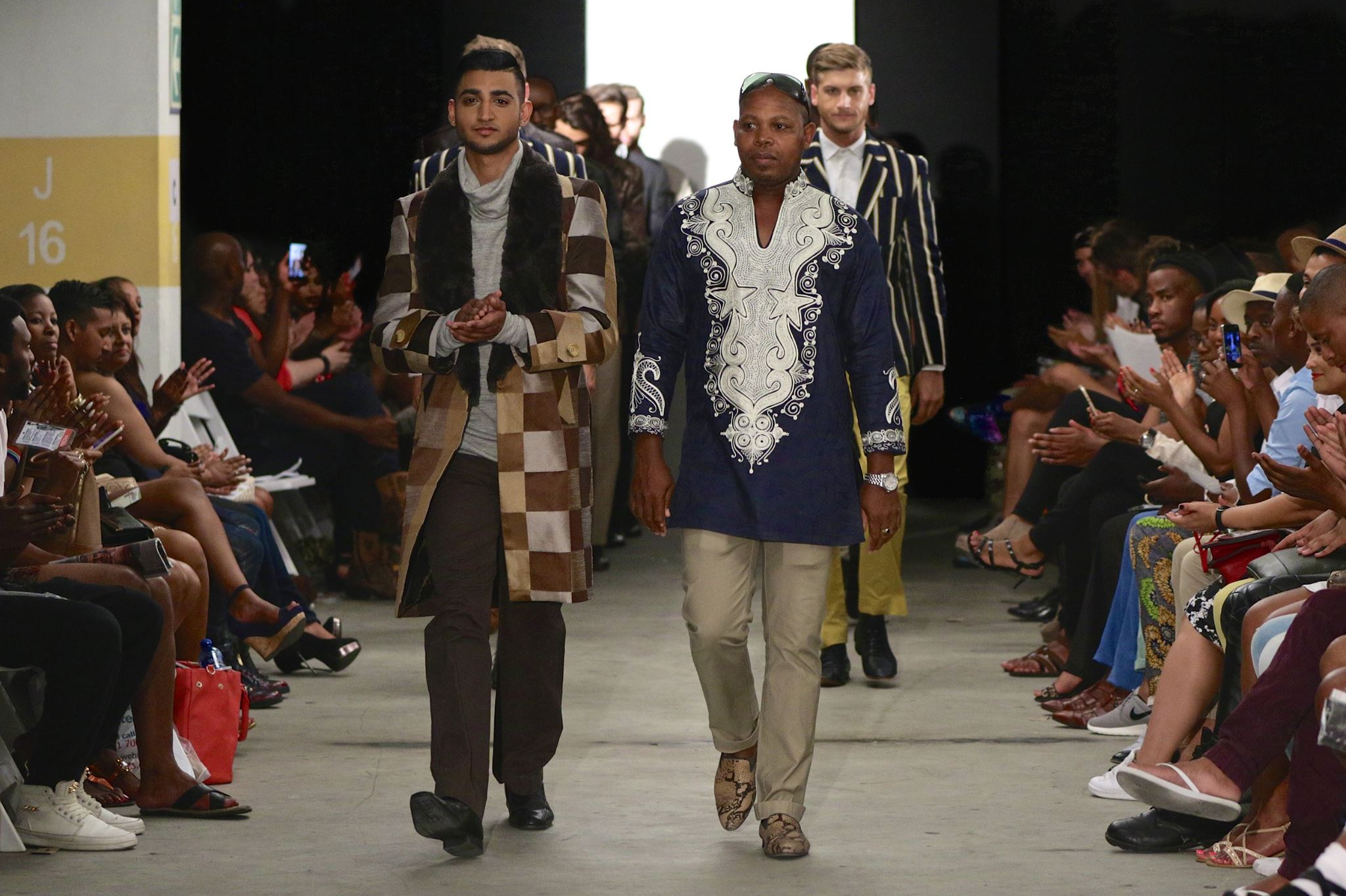 Tevin Naidu walking the ramp with fashion designer Nguni Shades. (Photo by Simon Deiner/ SDR photo)