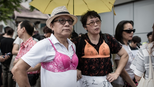 Protesters wear bras during a demonstration outside the police headquarters in Hong Kong on Aug 2, 2015. (Photo: AFP/Philippe Lopez)