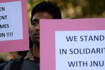 Indian students hold placards during a protest aganist the arrest of the president of Jawaharlal Nehru University's Student Union (JNU) Kanhaiya Kumar in New Delhi on February 14, 2016. Indian students,teachers and activists are protesting against the arrest of a top university student leader after he was charged with sedition, and demanding his immediate release. AFP PHOTO / SAJJAD HUSSAIN / AFP / SAJJAD HUSSAIN        (Photo credit should read SAJJAD HUSSAIN/AFP/Getty Images)