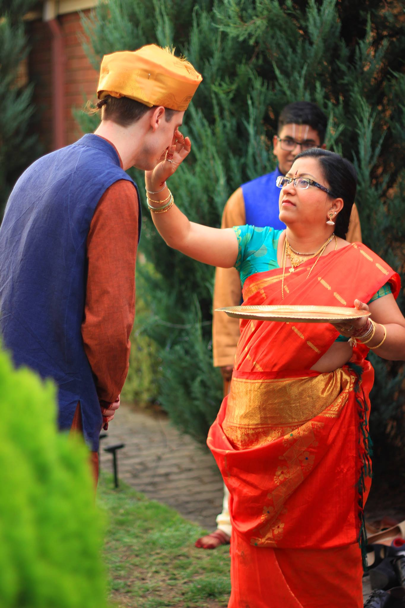 Salaphaty's mom waved a 'drishti arathi' to remove evil eye and invited the party in