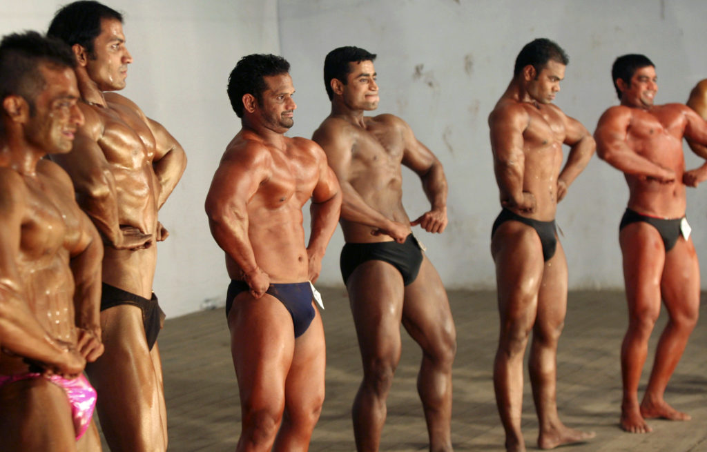 "Competitors flex their muscles during the ""Mr. Senior Gujarat 2010"" bodybuilding contest in the western Indian city of Ahmedabad January 31, 2010. More than 200 body builders across the state on Sunday participated in a contest organised by the Gujarat state body building association in an aim to encourage youth in body building sports and to aware common people about their health, a media release said. Picture taken January 31, 2010. REUTERS/Amit Dave (INDIA - Tags: SOCIETY) - RTR29Q0D"