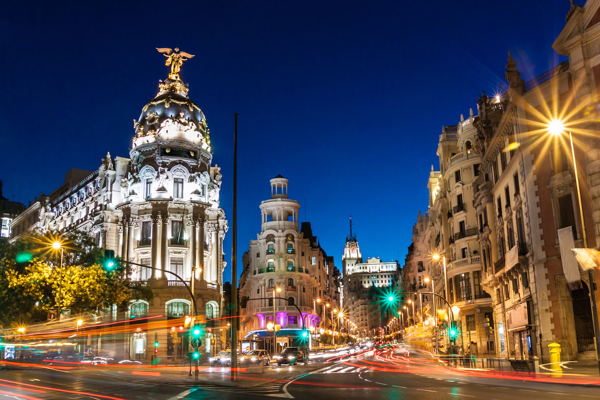 Rays of traffic lights on Gran via street, main shopping street in Madrid at night. Spain, Europe.