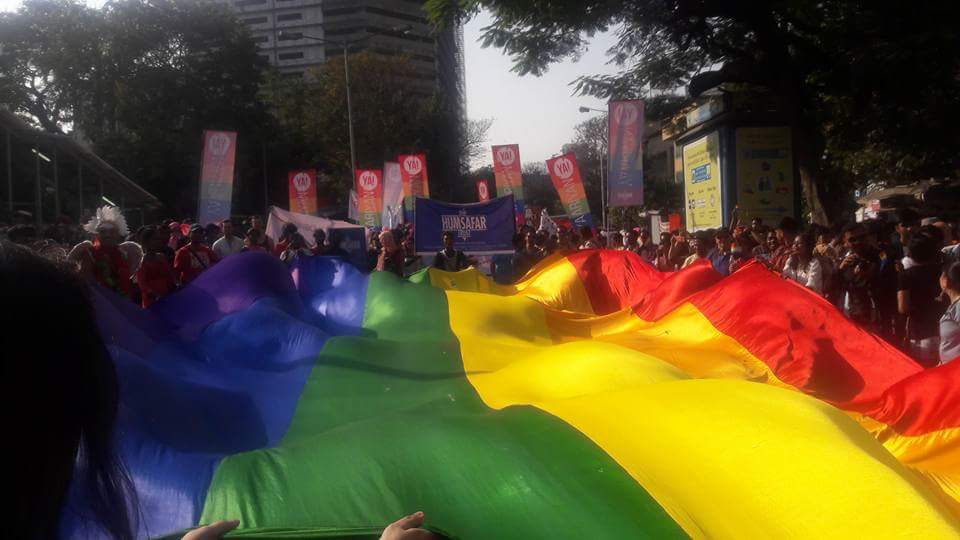 In the global tradition of Prides, a giant rainbow flag was unfurled and people danced under and around it.