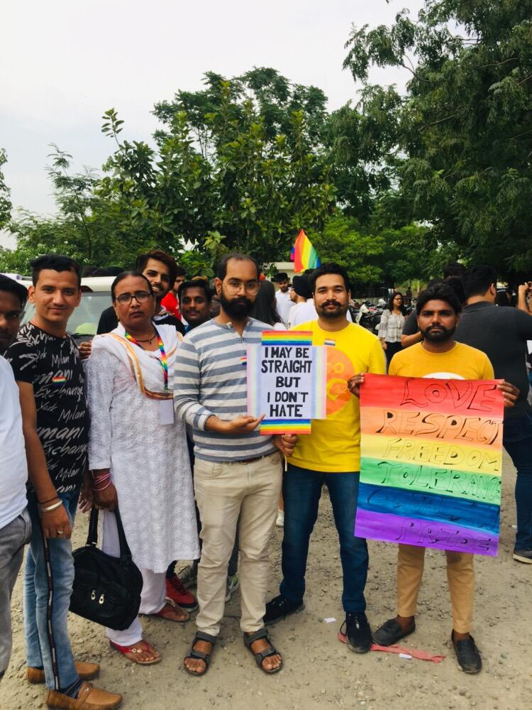 people holding banner at Amristar LGBTQ Pride