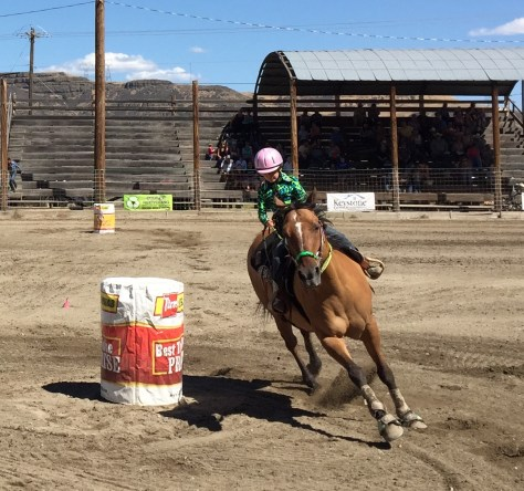 A tiny rider races the barrel course at the Ridge Riders Junior Rodeo.