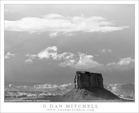 Storm, Monument Valley - Black and white photograph of incoming storm clouds looming over Monument Valley, Arizona