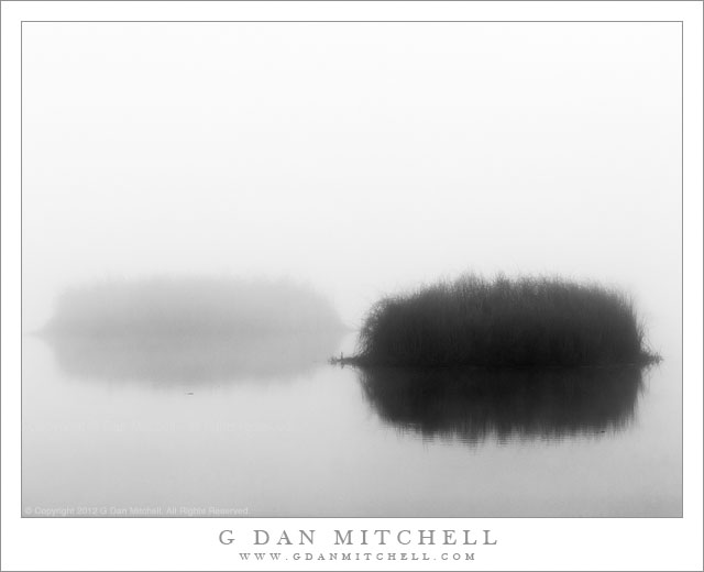 Two Islands, Fog - Two grass-covered islands in thick fog