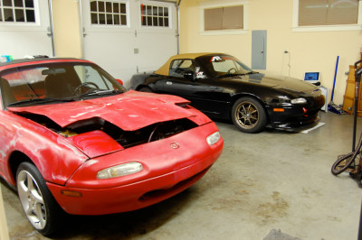 Laz parked with Nial's Miata