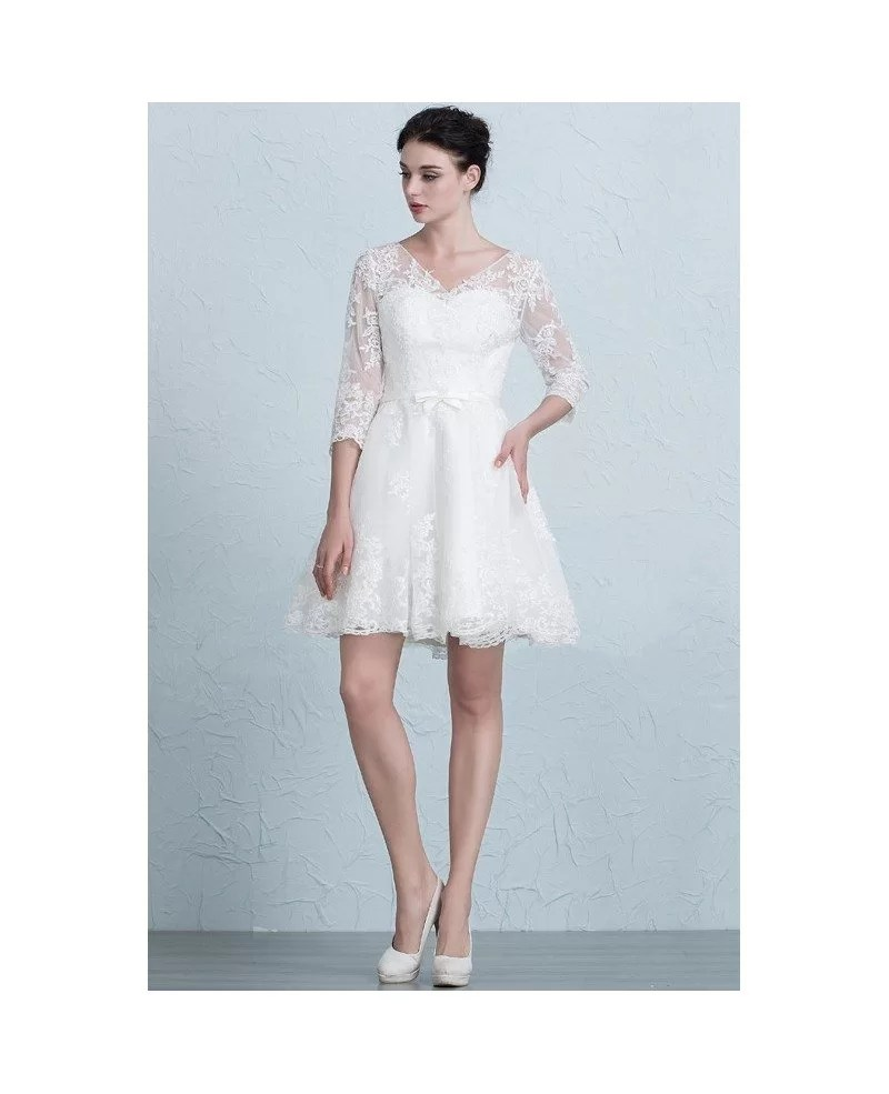 mira zwillinger wedding dresses bridal fashion week spring short tulle wedding dress Mira Zwillinger short wedding dress with lace and beaded top and silver tulle skirt from Spring