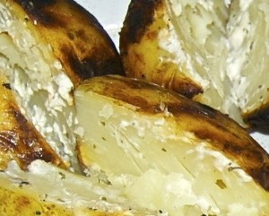 Campfire cooked baked potatoes, with Phili cheese and garlic spread
