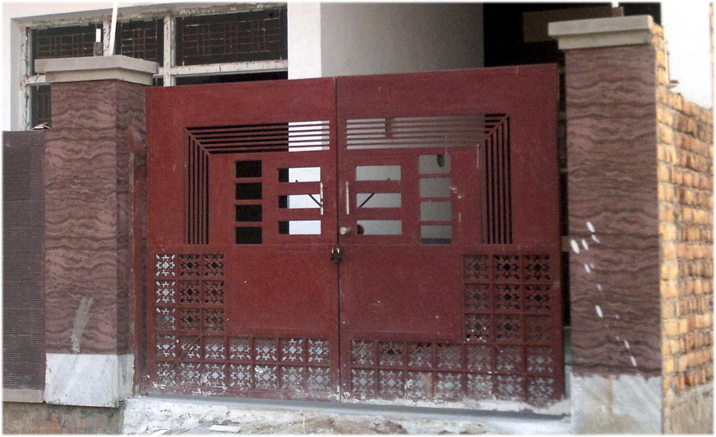 Main Door Design In Iron Sheet And Iron Grill Gharexpert