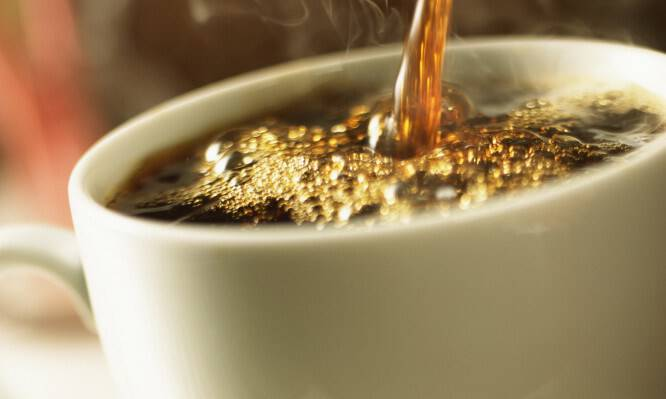 Steaming hot coffee being poured