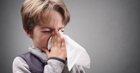 bigstock-Boy-suffering-flu-or-a-cold-bl-116296211