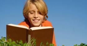 bigstock-Child-Reading-Book-Or-Bible-Ou-2602420
