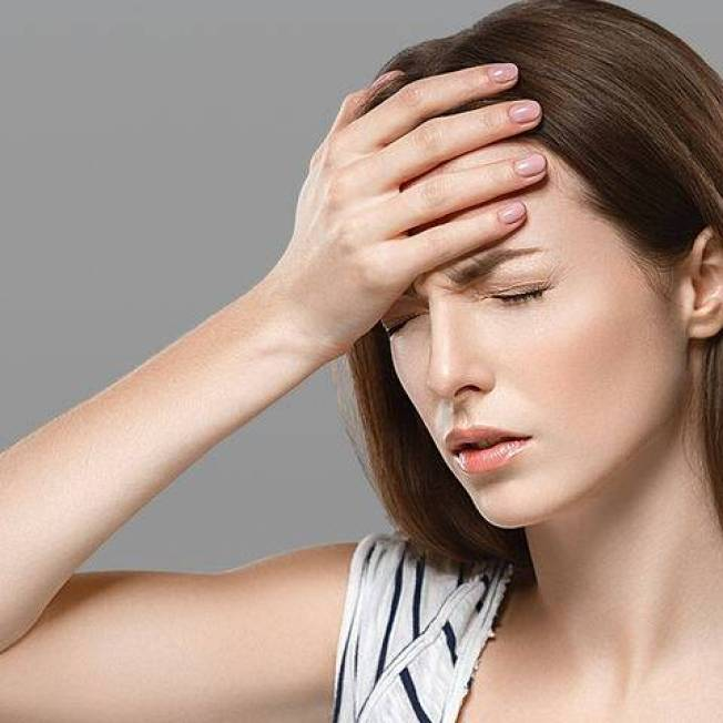 bigstock-Headaches-Beautiful-Young-Woma-126867653-1