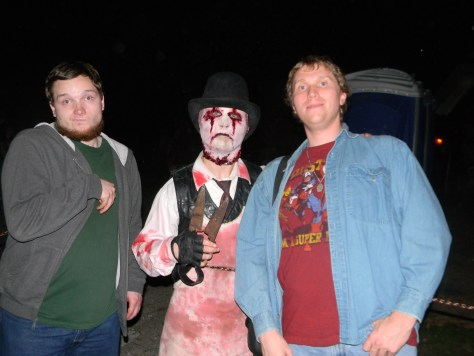 My brother Jarod Marchand (far left) and I (far right) hanging out with one of the Haunted Jail's many inmates (who's actually my co-worker Josh Case) in 2013.