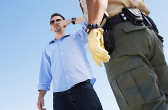 Cop Suspecting a Man of Drunk Driving