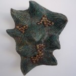 Brown Eggs in Green Hand, Ceramic Sculpture by Gina Lee Robbins