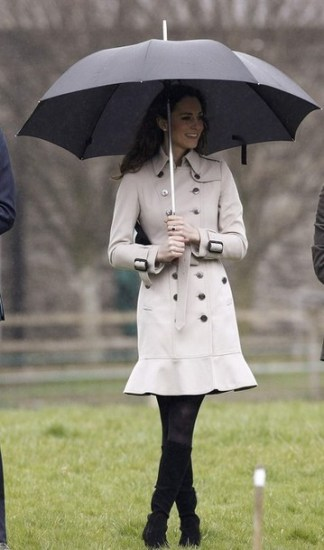 The Fiancee of Britain's Prince William, Kate Middleton, watches a tug of war match during a visit to the Greenmount Agriculture & Food College, in Antrim, Northern Ireland March 8, 2011. Cheering crowds and armed police greeted Prince William as he flew into Northern Ireland on Tuesday to show off his bride-to-be Kate Middleton. REUTERS/Phil Noble (NORTHERN IRELAND - Tags: ENTERTAINMENT SOCIETY ROYALS)