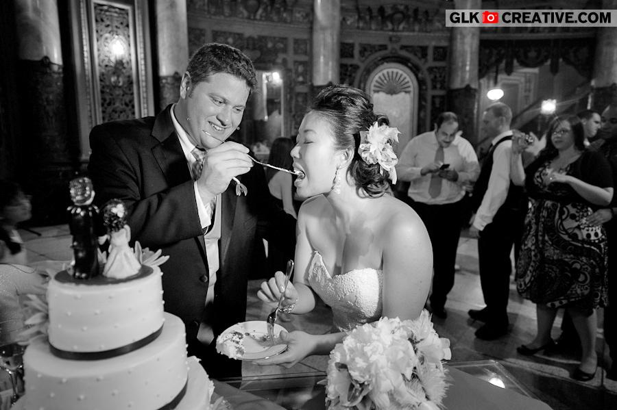 bride-groom-cutting-cake-at-landmark-loews-wedding