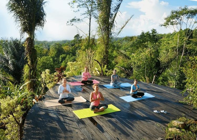 Teaching Yoga in Ubud, Bali. Photo Credit: Nailya Akhundova