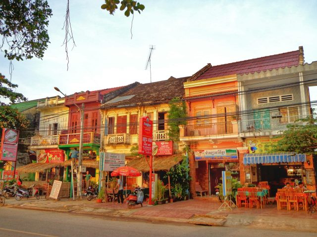 Delgithfully dilapidated french colonial buildings along the riverside in Kampot