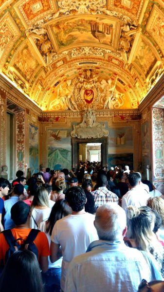 Visiting the Vatican with a thousand other people. Amazing ceiling but the Vatican museums get so crowded!