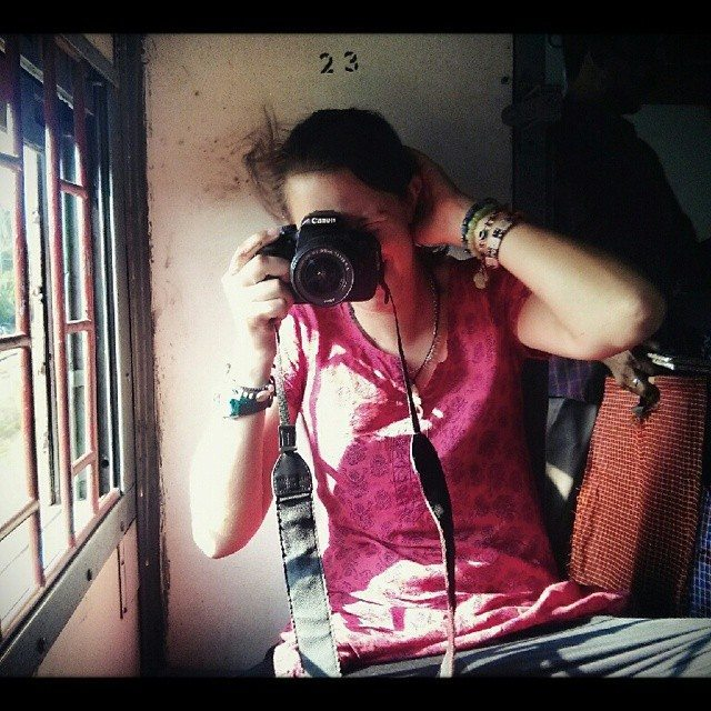 Taking photos with a DSLR on the train in India