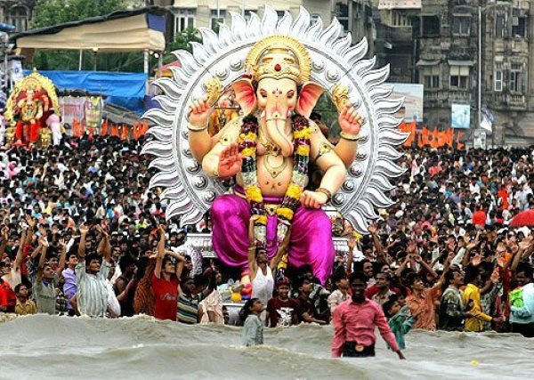 Ganesh being immersed in the water for Ganesh Chaturthi
