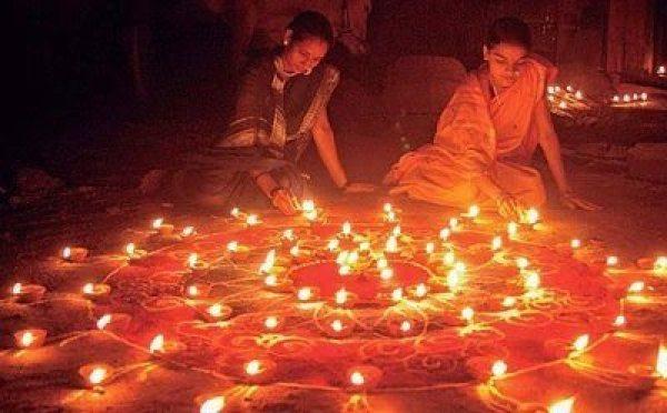 Lighting candles for Diwali