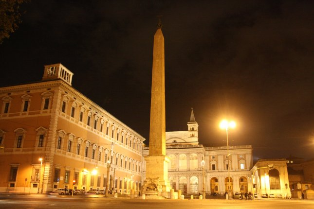 One of many obelisks in Rome at night.
