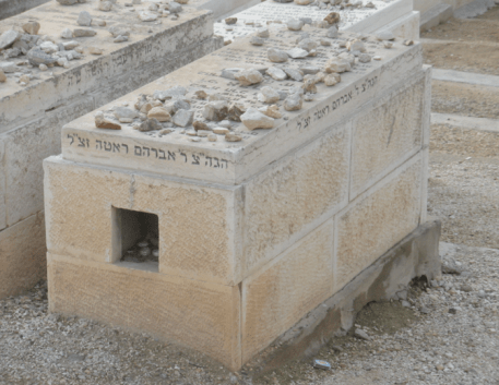 You can see the rocks on the tomb as a sign of respect