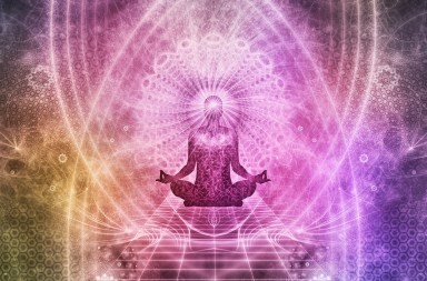 Person meditating in Lotus position. beams of light and energy are flowing all around.