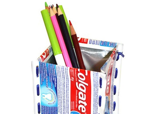 Pencil Holder - Looking for a refreshing alternative to throwing away your toothpaste tubes? This easy DIY project upcycles your empty toothpaste tubes into a simple toothbrush or pencil holder. Upcycling materials like these are a great way to reuse without costing a mint.