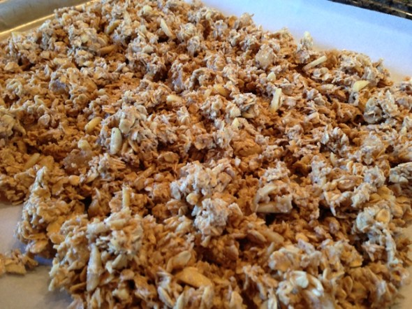 Add slivered-almonds and chai spices and lay it on a cookie sheet for the oven.