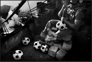 Football against War - Seaman Chris Welch, 27, pumps up soccer balls which will later be given while the Navy's Riverines are out on patrol in Iraq.  Photography: Ross Taylor