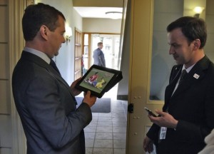 Russian President Dmitry Medvedev watches a World Cup 2010 match between Brazil and Portugal on his iPad before the start of the G8 Summit.