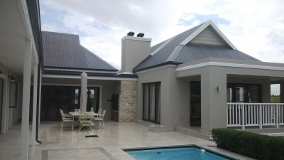 Kingswood - oustide entertainment area - fireplace, entertainment room, pool, patio and outdoor tiling
