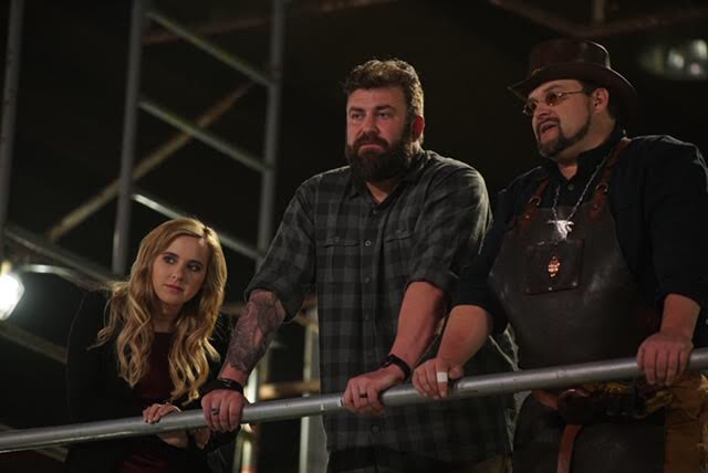 Ashley Hlebinsky, Zeke Stout, and Trenton Tye watching contestants compete on Master of Arms. Courtesy of Discovery.